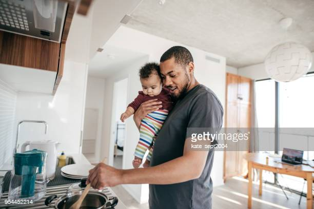 cooking time with daddy - single father stock pictures, royalty-free photos & images