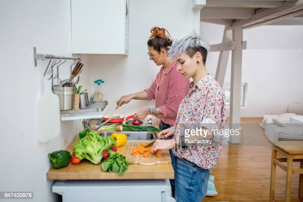 cooking together in the kitchen - alternative lifestyle stock pictures, royalty-free photos & images