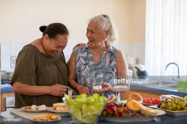 cooking together - pacific islanders stock pictures, royalty-free photos & images