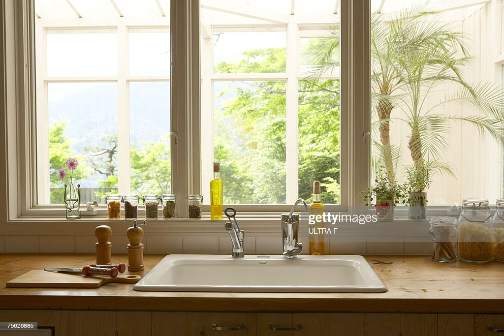 Cooking tools beside sink in kitchen : Stock Photo