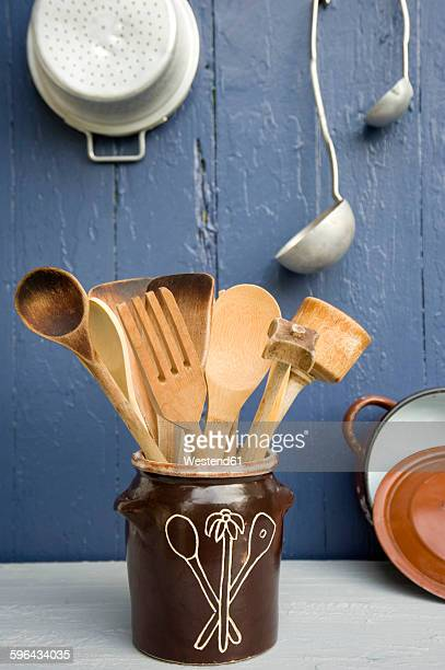 cooking utensils in clay pot - cooking utensil stock photos and pictures