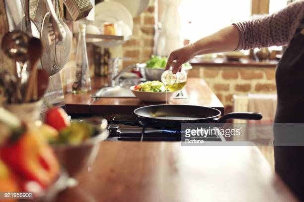 cooking vegetables, step four, pouring the olive oil - oil stock pictures, royalty-free photos & images
