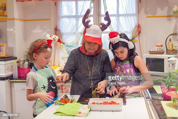 cooking with grandmother - carol cook stock pictures, royalty-free photos & images