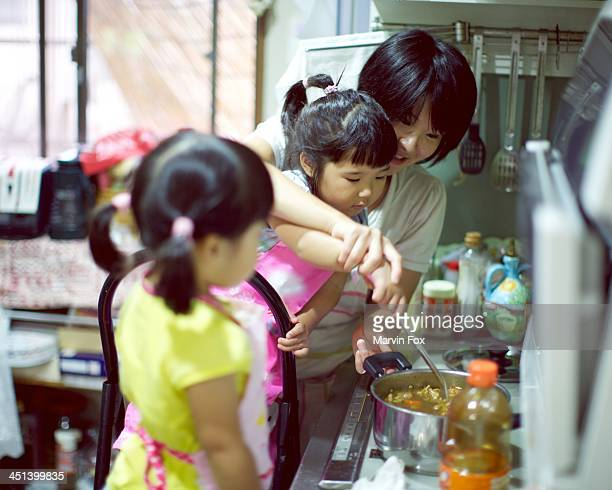 cooking with mummy - yonago stock photos and pictures