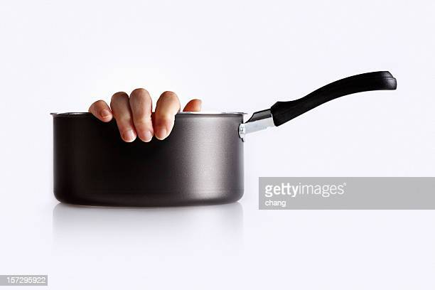 cooking with one hand - cannibalism stock photos and pictures