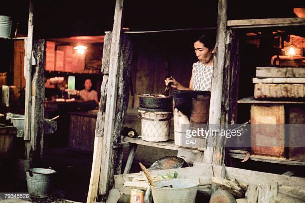 A cooking woman in Showa