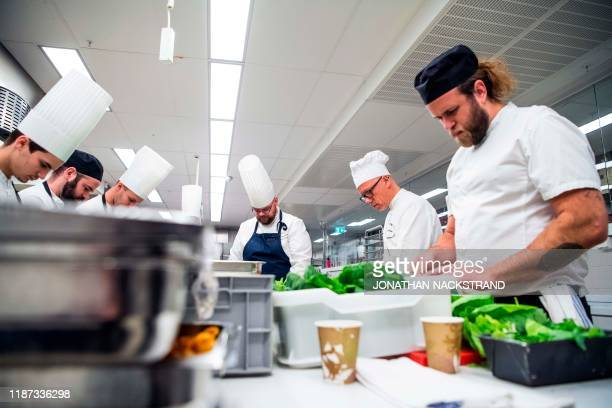 Cooks and kitchen workers prepare the 2019 Nobel Banquet in the kitchen of the Stockholm city hall on December 8, 2019. - The Nobel Prize awards...