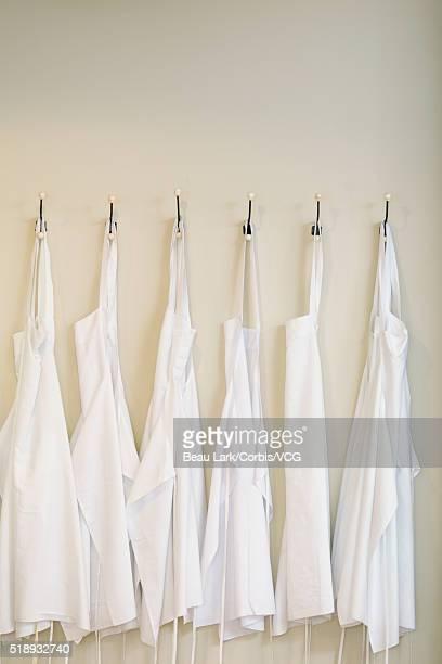 Cooks' aprons hanging on hooks