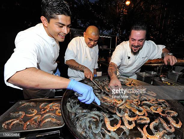 Cooks Daniel Pineda and Javier Rosete and executive chef Mike Minor cook Blue Oasis Pure Shrimp from the company's North Dakota research and...