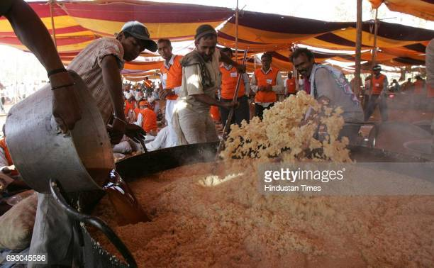 Cooks from Rajastan stirs the sheera at the Shabri Kumbh festival at dang district of Gujrat