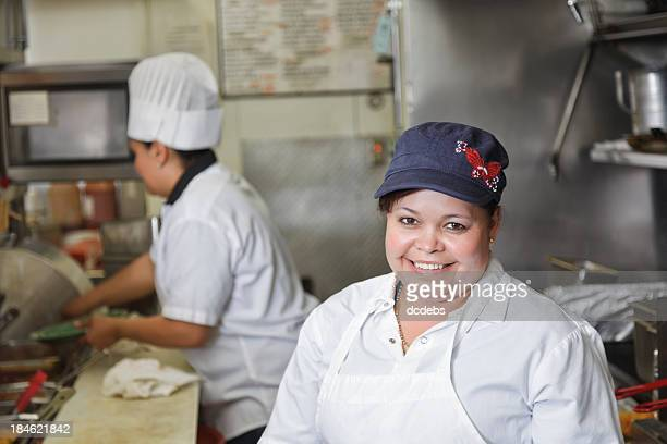 Cooks in Kitchen of Mexican Restaurant