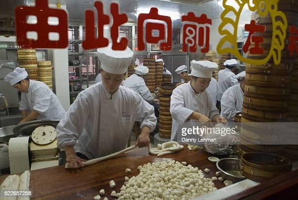 Cooks in Nan Xiang Steamed Bun Resturant