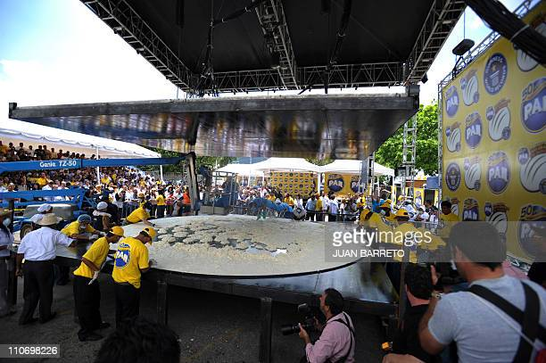 Cooks make a huge arepa to set a Guinness record in Caracas March 23 2011 Venezuelan food giant Empresas Polar on Wednesday broke the Guinness record...