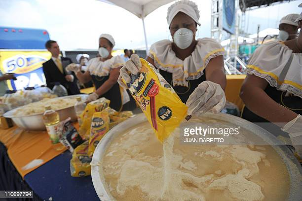 Cooks make dough for an arepa to set a Guinness record in Caracas March 23 2011 Venezuelan food giant Empresas Polar on Wednesday broke the Guinness...