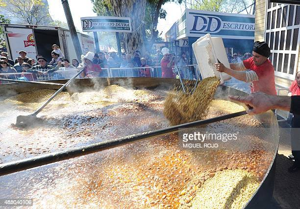 Cooks prepare a lentil stew in a giant pot in an attempt to break a Guinness Record during the Prado Rural fair in Montevideo on September 13 2015 To...