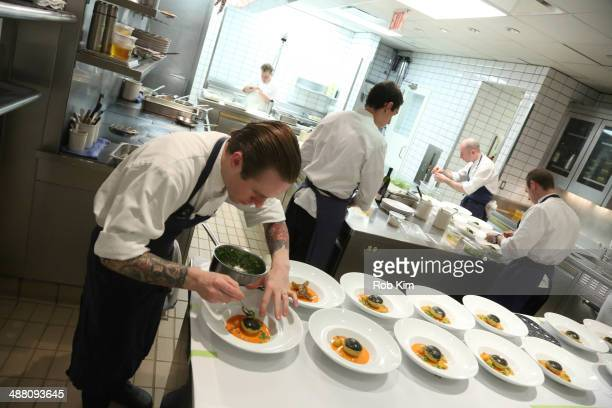 Cooks prepare dishes in the kitchen at Starwood Preferred Guest's Gourmet Experience of a Lifetime with Chef Thomas Keller at Per Se for Luck SPG...