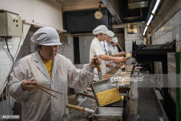 Cooks prepare omelettes in a restaurant in Tsukiji fish market on September 4 2017 in Tokyo Japan The market was built in 1935 following the great...