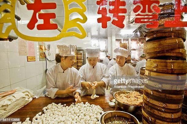 Cooks preparing dumplings in Yuyuan Bazaar