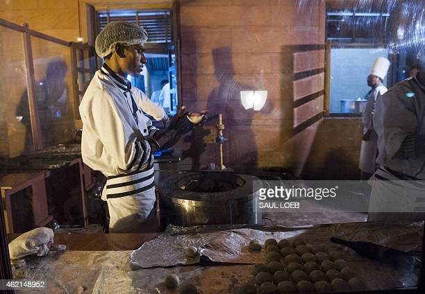 Cooks preparing food outside for a State Dinner in honor of US President Barack Obama at Rashtrapati Bhawan the Presidential Palace in New Delhi...
