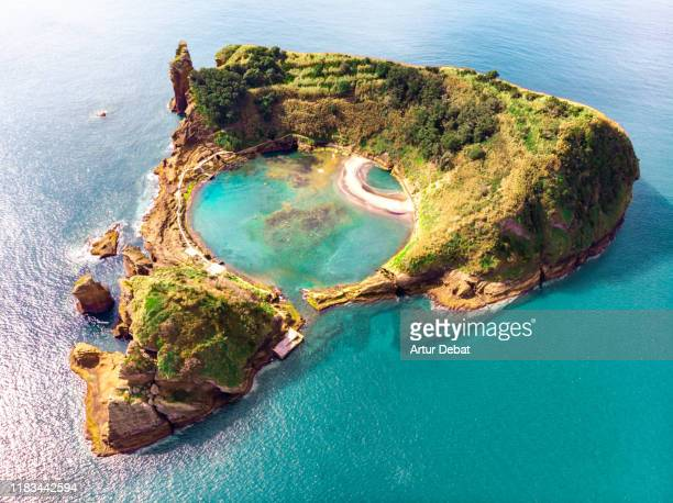 cool aerial view of circle pool inside volcanic island with eye shape in the azores islands. - las azores fotografías e imágenes de stock