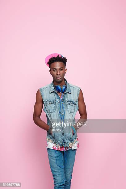 Cool afro american guy, summer studio portrait, pink background