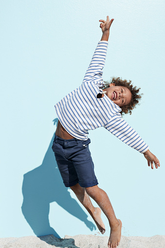 cool and cute boy jumping on beach with backdrop - gettyimageskorea
