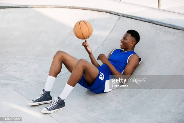 Cool basketball player spinning a ball on his finger
