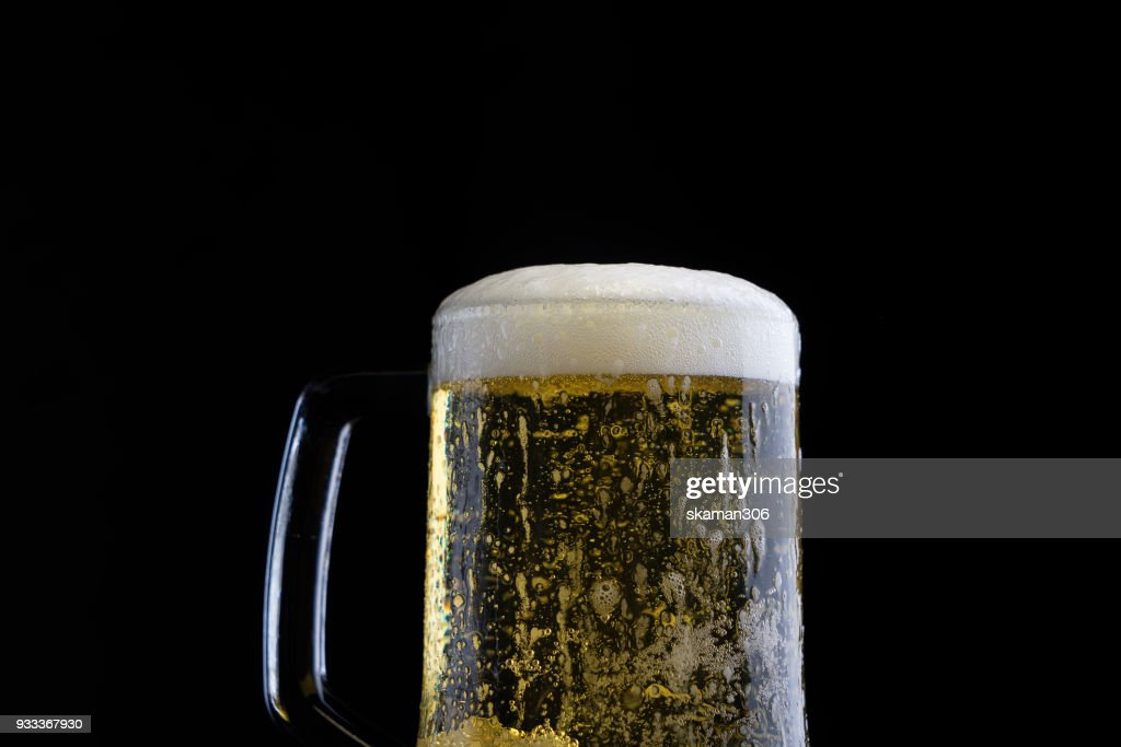 cool beer with foam stock photo getty images