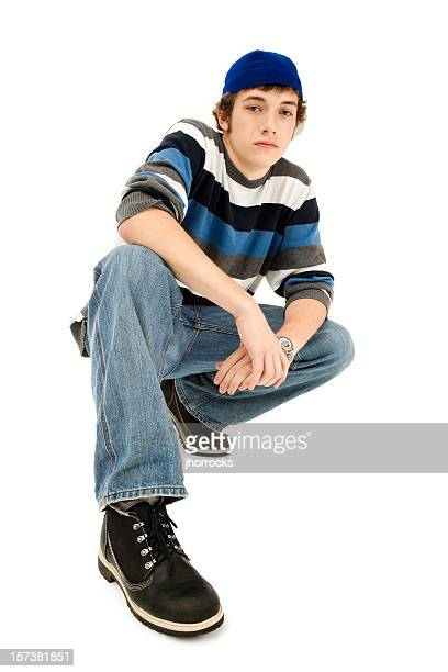 cool casual teen crouching - cap stock pictures, royalty-free photos & images