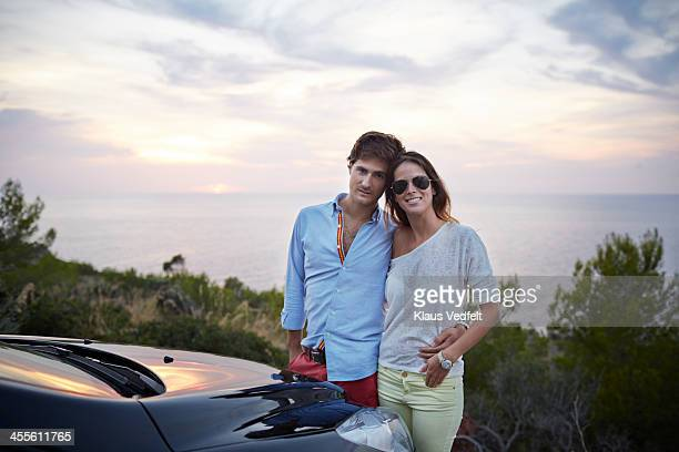 cool couple hanging out by their car - klaus vedfelt mallorca stock pictures, royalty-free photos & images