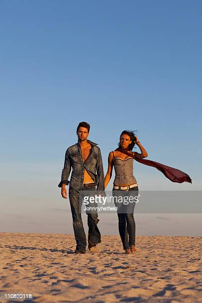 Cool couple walking in the sand
