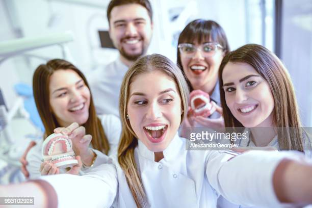 Cool Dental Colleagues Taking Selfie After Successful Work