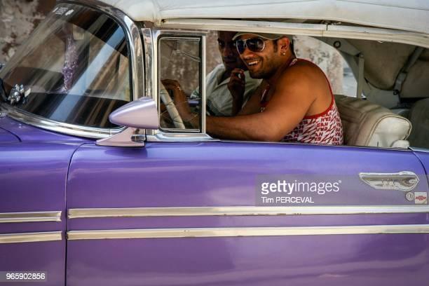 Cool dudes purple car Havana