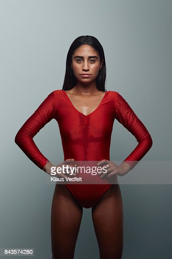 Cool female gymnast looking in camera, wearing leotard