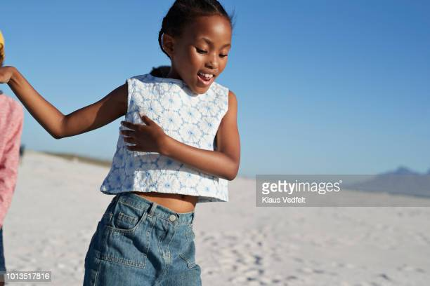 cool girl dancing on the beach - sleeveless stock pictures, royalty-free photos & images