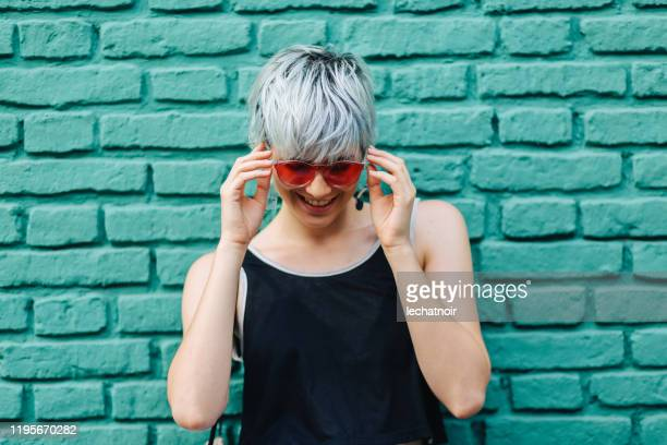 cool girl with sunglasses posing - teal stock pictures, royalty-free photos & images