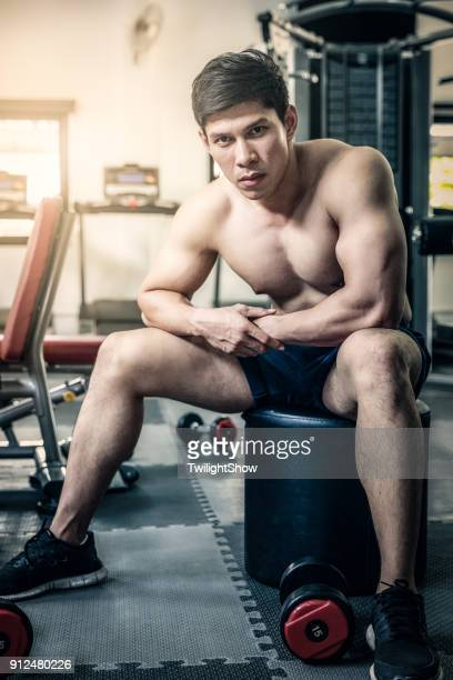 cool guy workout - asian six pack stock photos and pictures