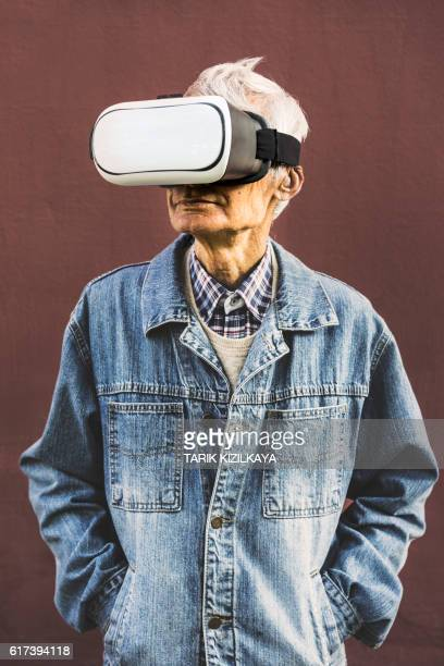 Cool hipster grandpa wearing virtual reality glasses