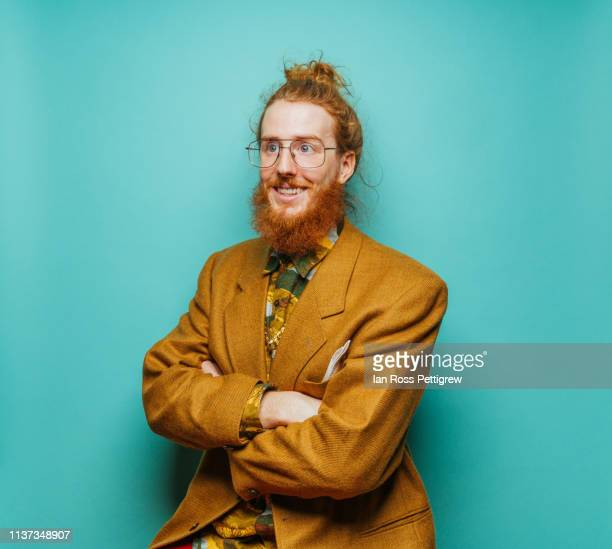 cool hipster man on blue background - nerd stock pictures, royalty-free photos & images