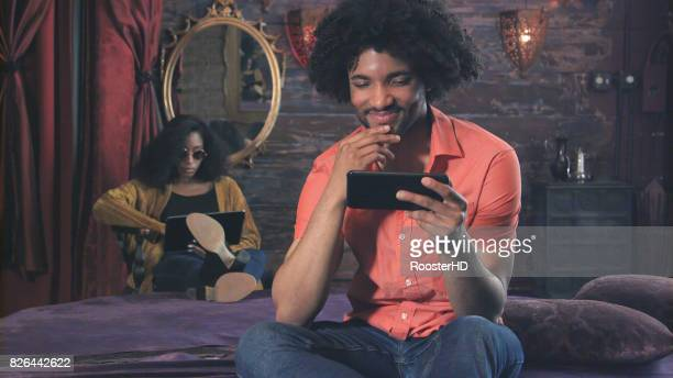 Cool Hipster Young Man has Positive Interaction with Smart Phone