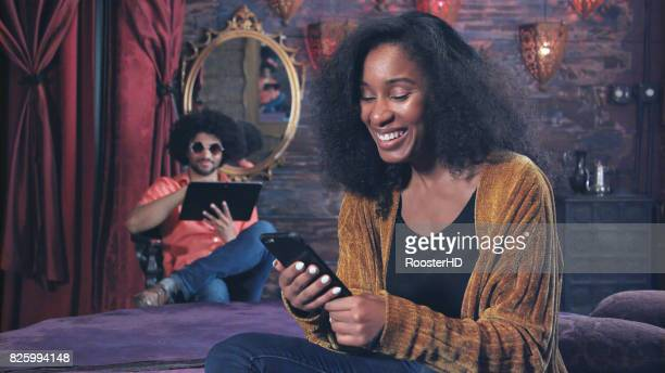 Cool Hipster Young Woman has Positive Interaction with Smart Phone