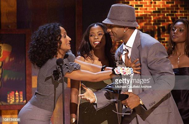 LL Cool J accepts the award for Outstanding Box Office Movie for Deliver Us from Eva from presenters Tracee Ellis Ross and Golden Brooks