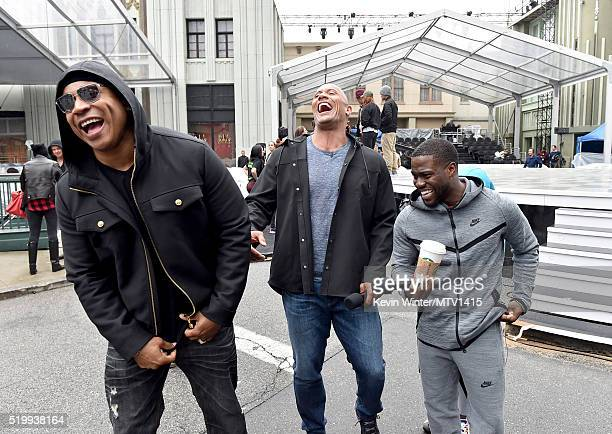 LL Cool J and cohosts Dwayne Johnson and Kevin Hart laugh backstage during rehearsals for the 2016 MTV Movie Awards at Warner Bros Studios on April 8...
