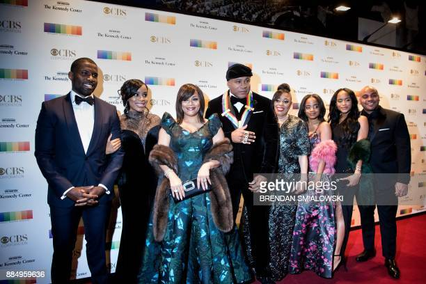 LL Cool J and family arrive for the 40th Annual Kennedy Center Honors in Washington DC on December 3 2017 / AFP PHOTO / Brendan Smialowski
