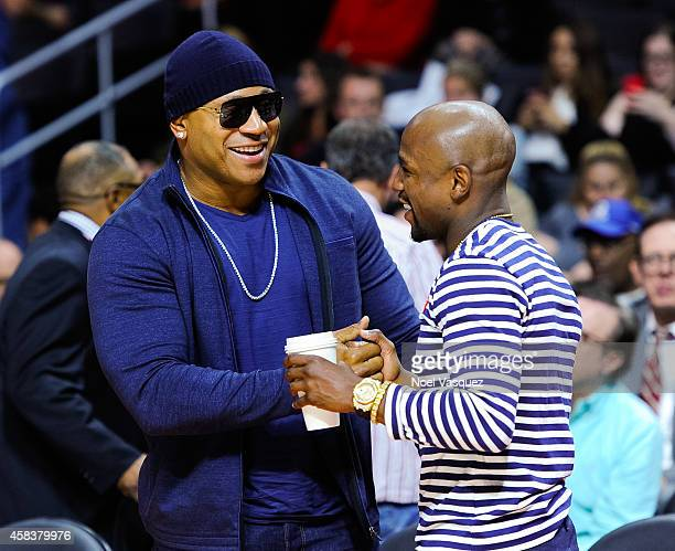 Cool J and Floyd Mayweather Jr attend a basketball game between the Utah Jazz and the Los Angeles Clippers at Staples Center on November 3 2014 in...
