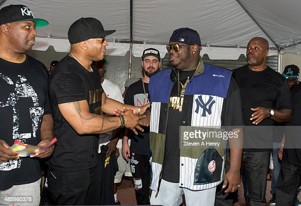 Cool J and Lee 'Q' O'Denat attend the 2015 BackToSchool Backpack Giveaway at Jamaica Colosseum Mall on August 30 2015 in New York City