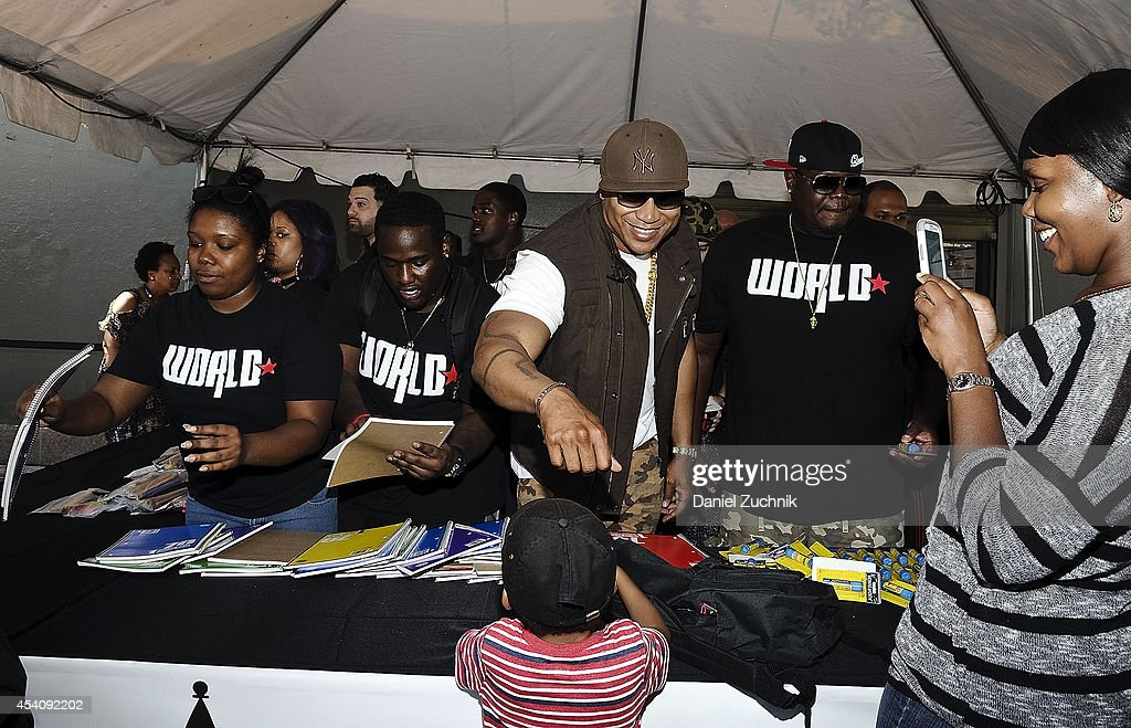LL Cool J and WorldStarHipHop CEO Lee O'Denat attend the 2nd Annual Worldstar Foundation Back To School Giveaway at Jamaica Colosseum Mall on August 24, 2014 in New York City.