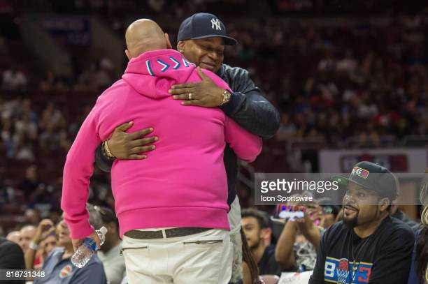 Cool J greets rapper Fat Joe during a BIG3 Basketball league game on July 16 2017 at Wells Fargo Center in Philadelphia PA