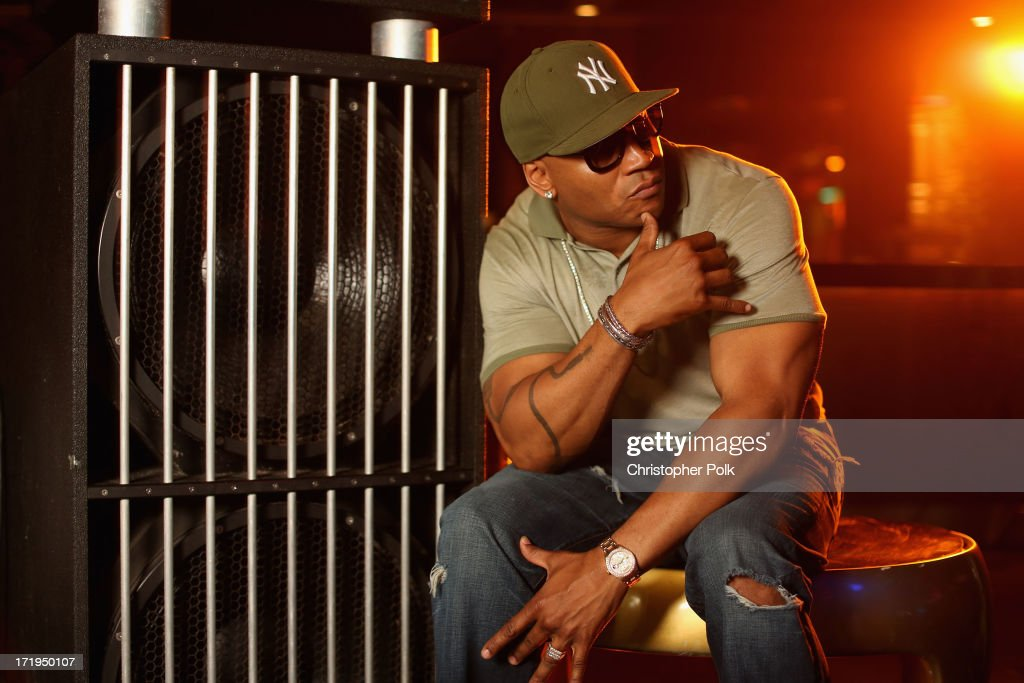 LL Cool J poses in the Wonderwall Portrait Studio at the iHeartRadio Ultimate Pool Party Presented by VISIT FLORIDA at Fontainebleau's BleauLive in Miami featuring live performances by Pitbull, Ke$ha, Afrojack, Icona Pop, Krewella and Jason Derulo on June 29, 2013 in Miami Beach, Florida.
