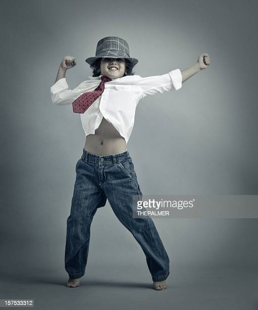 cool kid dancing on gray background